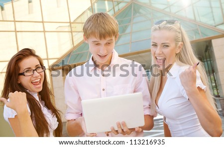 two businesswomen and businessman showing business success - stock photo