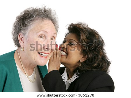 Two businesswomen gossiping and trading secrets.  Isolated on white. - stock photo