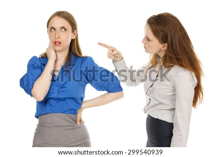 Two businesswomen in a finger pointing argument..