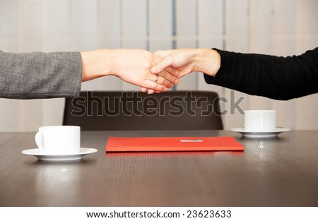 two businesswomen in the office after meeting