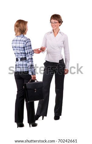 Two businesswomen introduce themselves by business card - stock photo