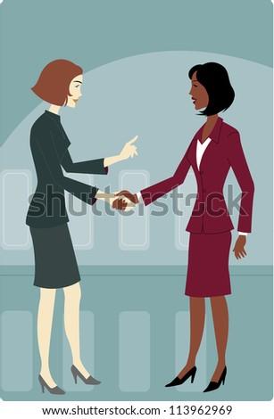 Two businesswomen shaking hands - stock photo