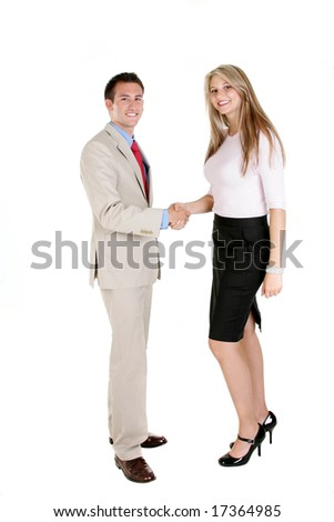 Two businesswomen shaking hands and smiling. - stock photo