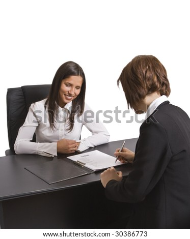Two businesswomen signing a contract in the office. All the documents are mine.