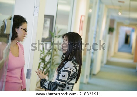 Two businesswomen talking - stock photo