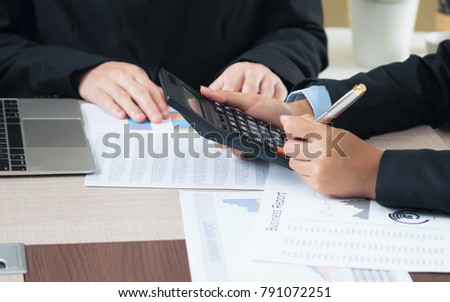 two businesswomen working with papers accountant or banker making 