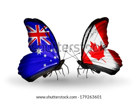 Two butterflies with flags on wings as symbol of relations Australia and Canada - stock photo