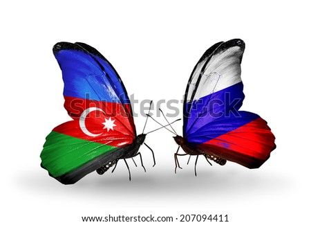 Two butterflies with flags on wings as symbol of relations Azerbaijan and  Russia - stock photo