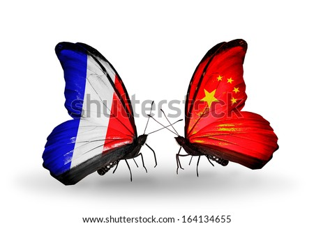 Two butterflies with flags on wings as symbol of relations France and China - stock photo