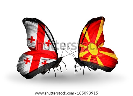 Two butterflies with flags on wings as symbol of relations Georgia and Macedonia - stock photo