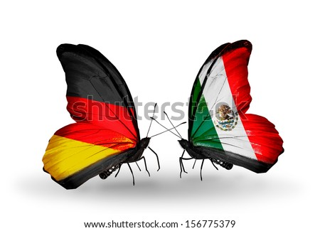 Two butterflies with flags on wings as symbol of relations Germany and Mexico - stock photo