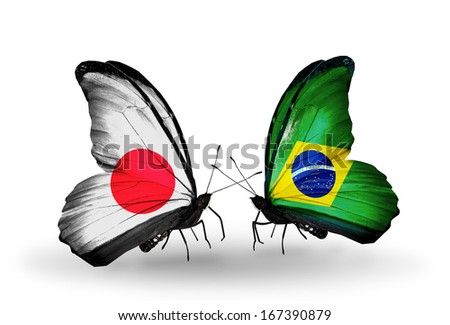 Two butterflies with flags on wings as symbol of relations Japan and Brazil - stock photo