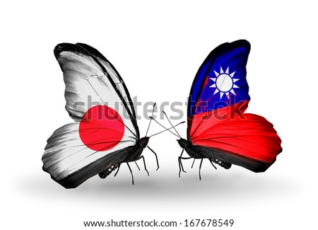 Two butterflies with flags on wings as symbol of relations Japan and Taiwan - stock photo