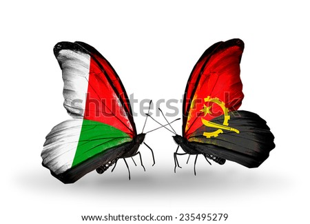 Two butterflies with flags on wings as symbol of relations Madagascar and Angola - stock photo