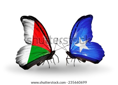 Two butterflies with flags on wings as symbol of relations Madagascar and Somalia - stock photo