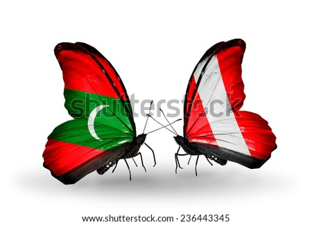 Two butterflies with flags on wings as symbol of relations Maldives and Peru - stock photo