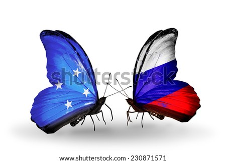Two butterflies with flags on wings as symbol of relations Micronesia and Russia - stock photo
