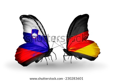 Two butterflies with flags on wings as symbol of relations Slovenia and Germany - stock photo