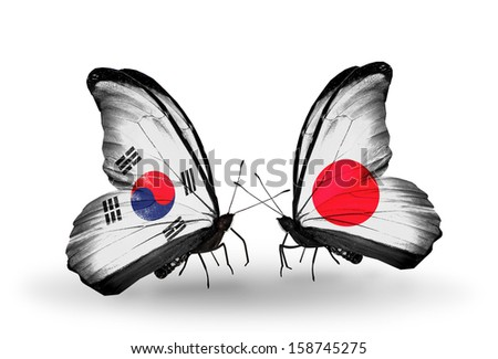 Two butterflies with flags on wings as symbol of relations South Korea and Japan - stock photo
