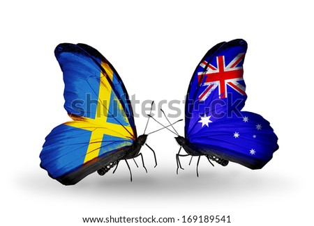 Two butterflies with flags on wings as symbol of relations Sweden and Australia - stock photo