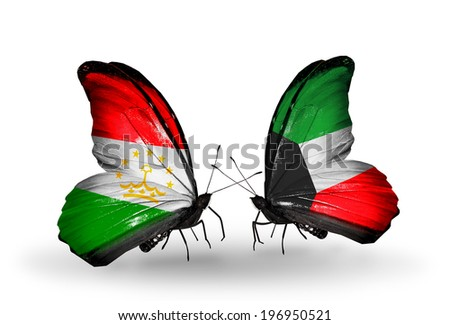 Two butterflies with flags on wings as symbol of relations Tajikistan and Kuwait - stock photo