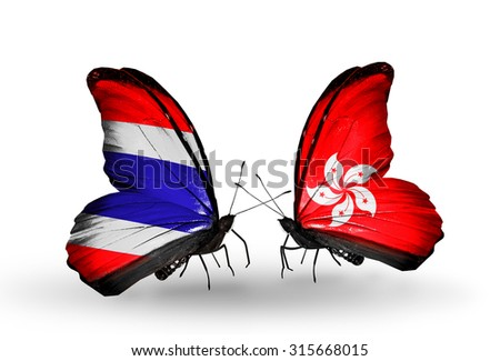 Two butterflies with flags on wings as symbol of relations Thailand  and Hong Kong - stock photo