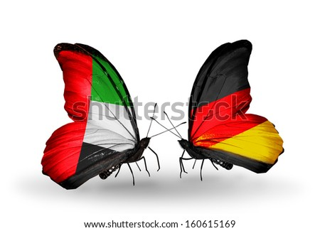 Two butterflies with flags on wings as symbol of relations UAE and Germany - stock photo