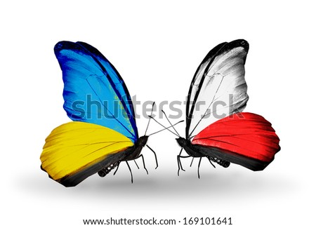 Two butterflies with flags on wings as symbol of relations Ukraine and Poland - stock photo