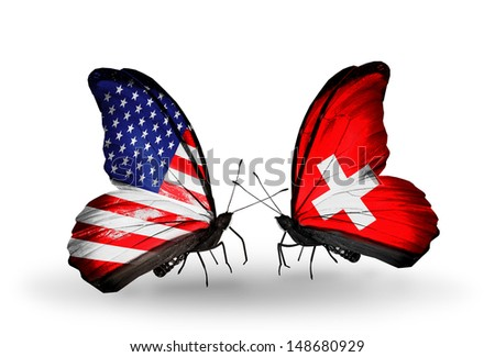 Two butterflies with flags on wings as symbol of relations USA and Switzerland - stock photo