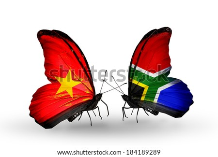 Two butterflies with flags on wings as symbol of relations Vietnam and South Africa - stock photo