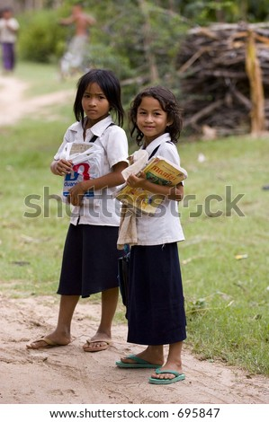 two cambodian school children - stock photo