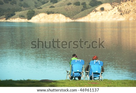 two campers look out onto cachuma lake in santa barbara county - stock photo