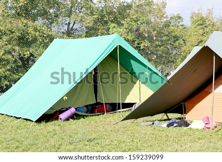 two Canadian tents set up in a boy scout camp - stock photo