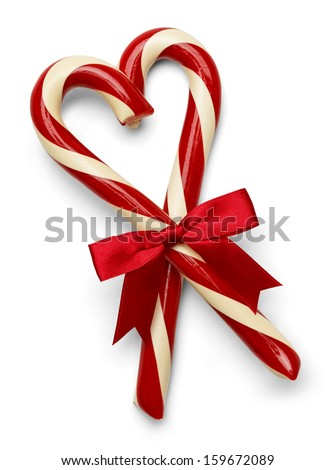 Two Candy Canes in Heart Shape with Red Bow Isolated on White Background. - stock photo