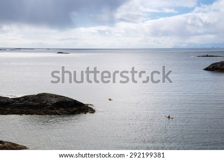 two canoes swimming in a sea, Lofoten Islands