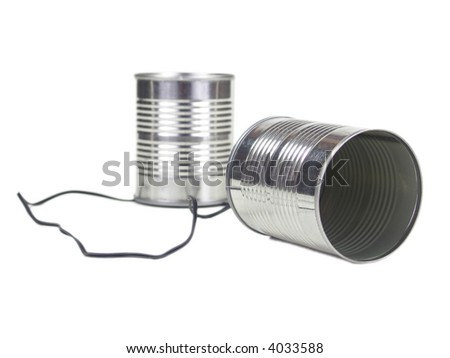Two cans attached by a wire isolated on white.