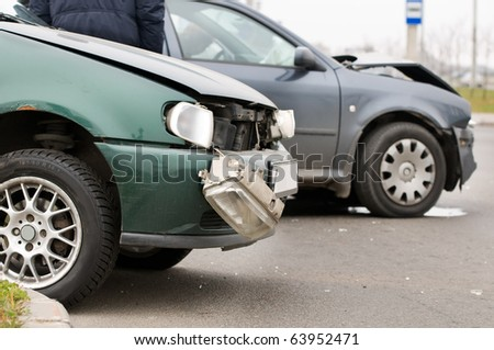 Two car crash accident on a road in city - stock photo