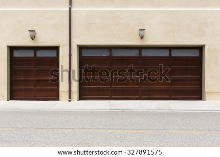 Two car garage door with stone - stock photo