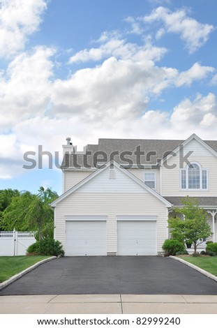 Two Car Garage Doors Suburban Home Driveway