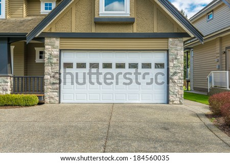 two-car garage on a sunny day in Vancouver, Canada