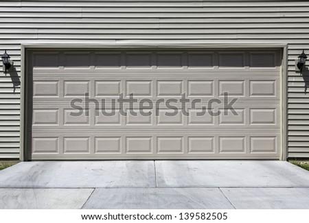 Two car siding garage - stock photo