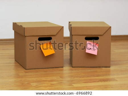 two cardboard boxes on wooden background, free/ for sale concept - stock photo