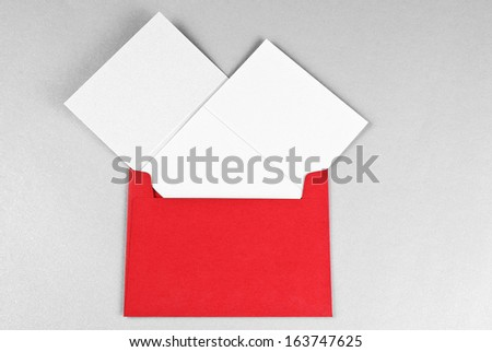 Two cards in red envelope - stock photo