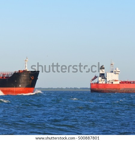 Two cargo ships sailing in blue sea close to Vlissingen, the Netherlands