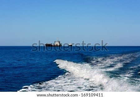Two cargo vessels at sea in the roads waiting to enter the seaport - stock photo