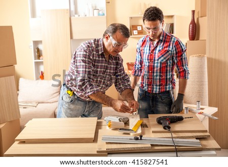 Beau Two Carpenters Working At Location.Repairing Furniture.