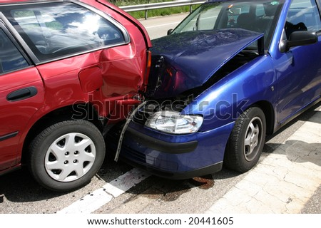 Two cars damaged in an accident - stock photo