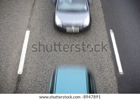 two cars on highway - stock photo