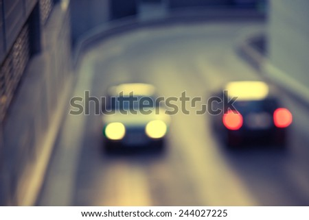 Two cars with white lights and red lanterns are going to meet each other - stock photo