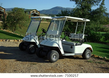 Two carts in golf club early morning